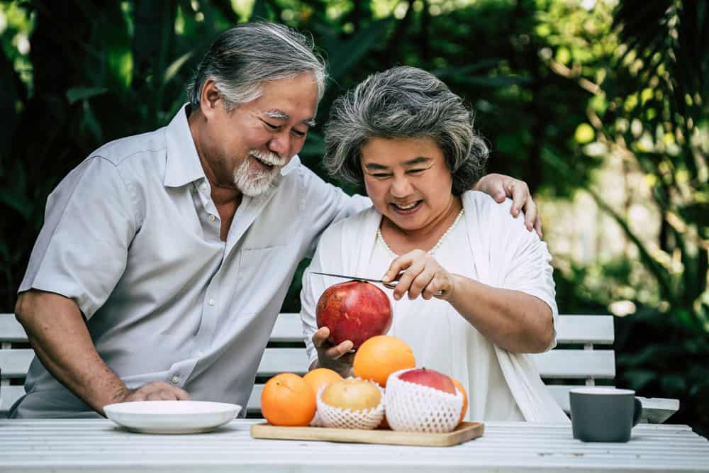 elderly-couples-playing-eating-some-fruit
