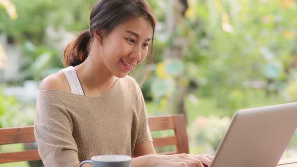 woman smiling at-laptop