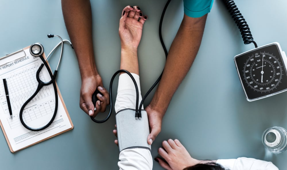 Nurse measuring patient blood pressure