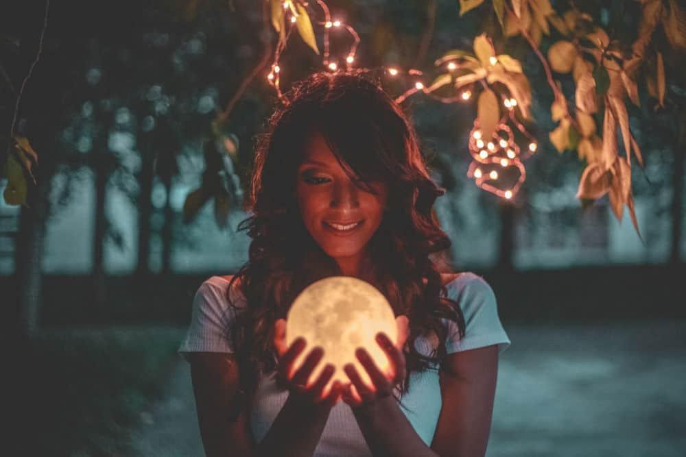 woman holding light