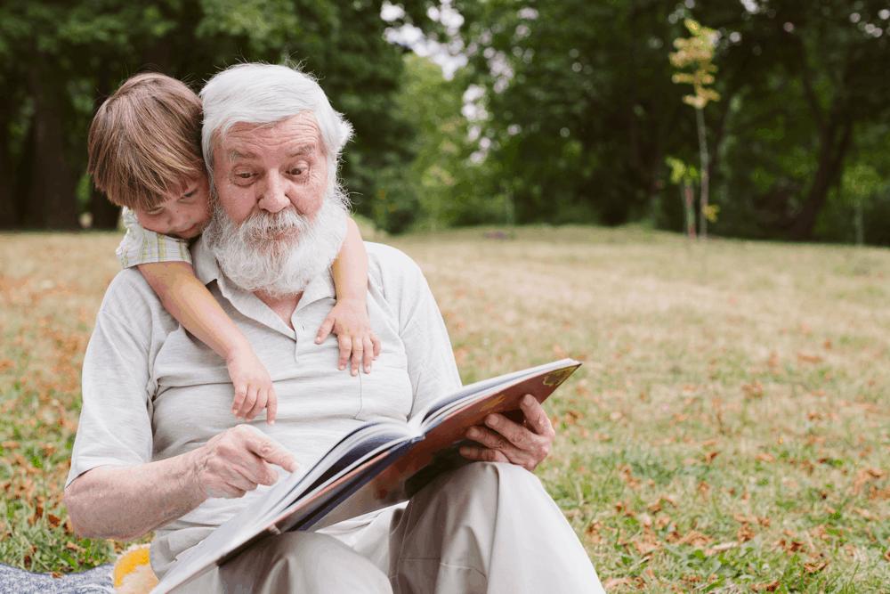 grandpa reading with grandchild