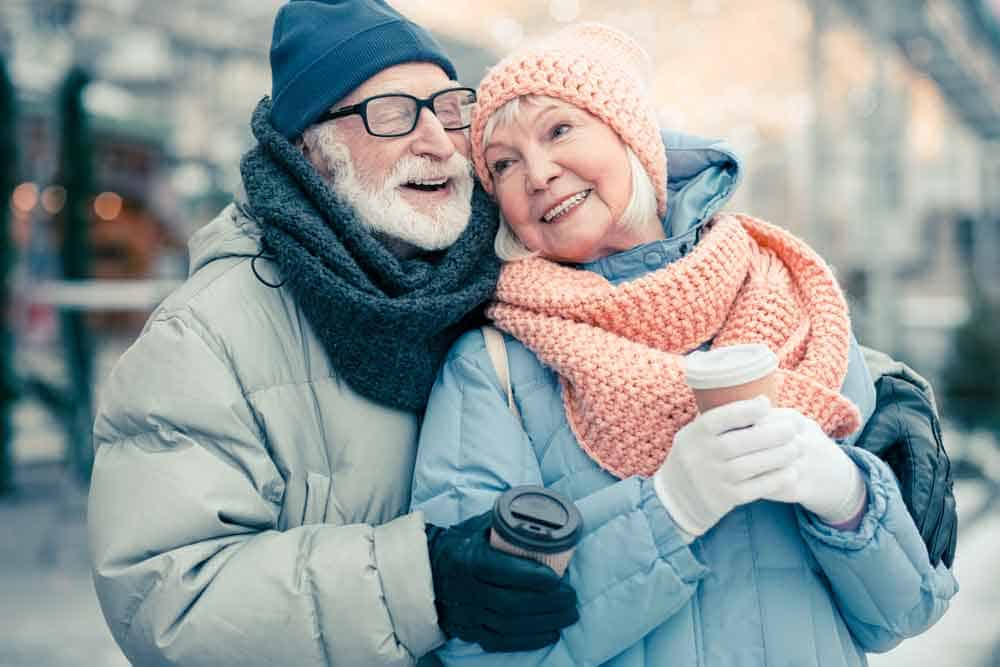 senior couple hugging in cold weather