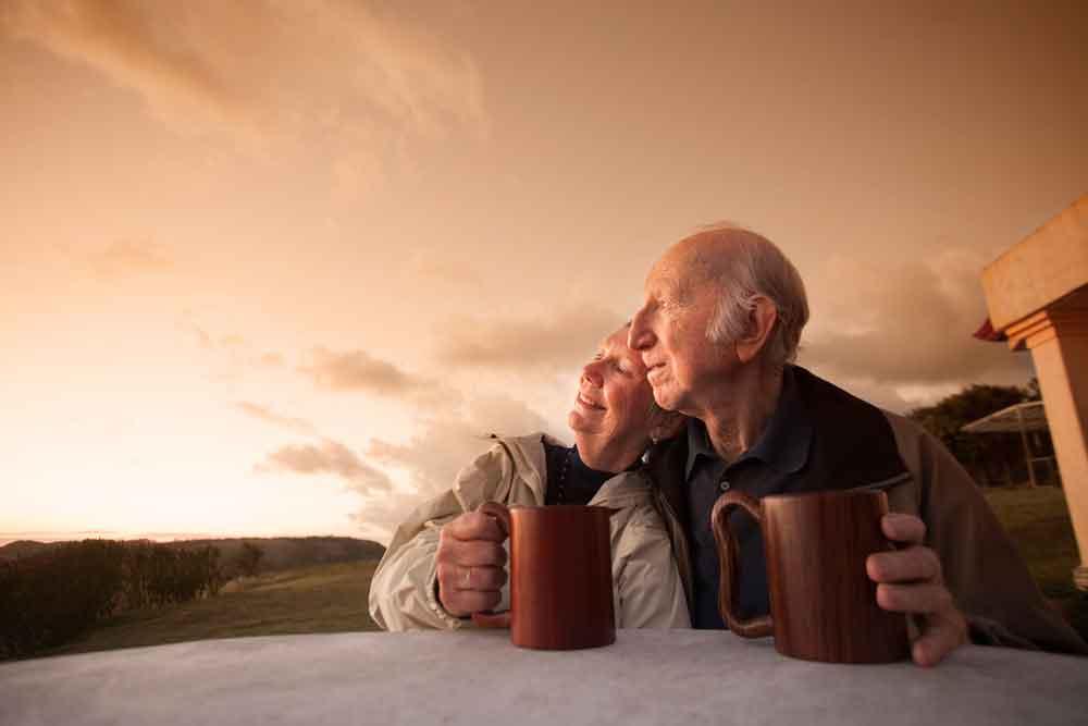 couple relaxing enjoying sunset
