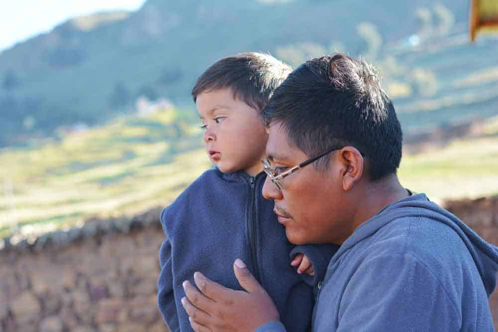 man with son in countryside