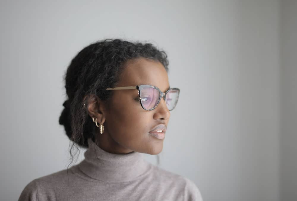 shallow-focus-african-american-female-with-glasses-wearing-gray-turtleneck