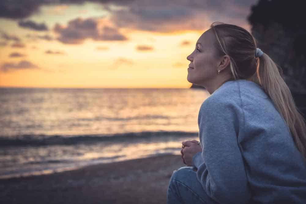 woman at the beach at sunset