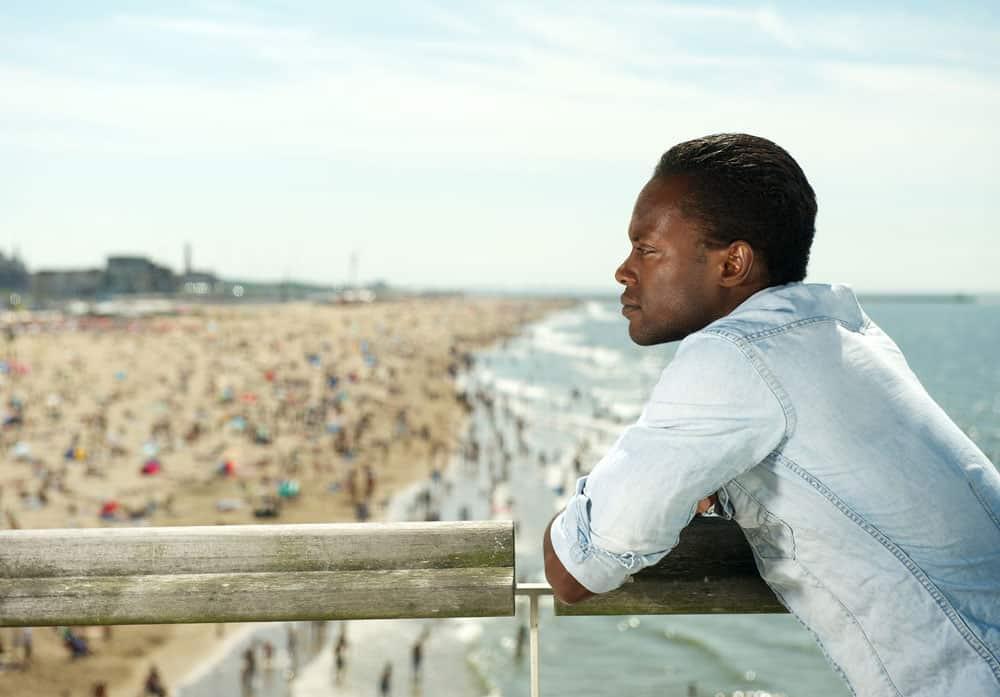man-contemplating-at-beach