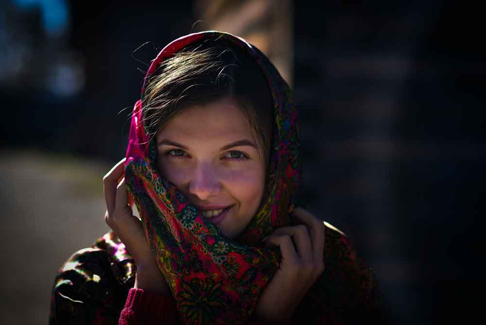 woman holding pink floral scarf