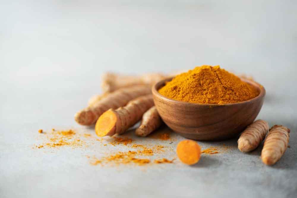 turmeric-powder-wooden-bowl-fresh-turmeric-root