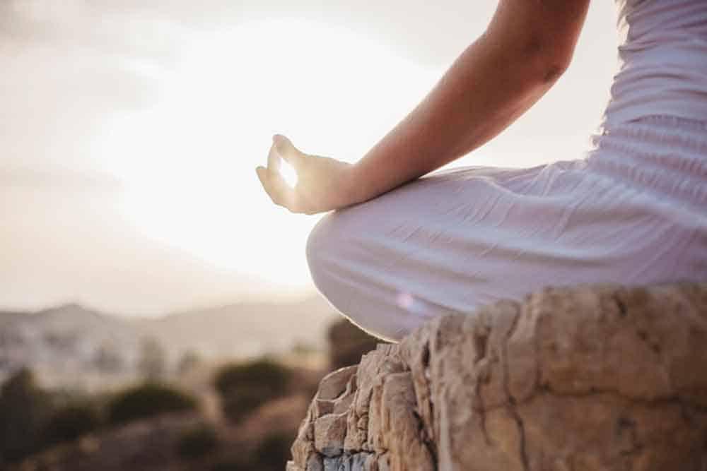 close up woman meditating
