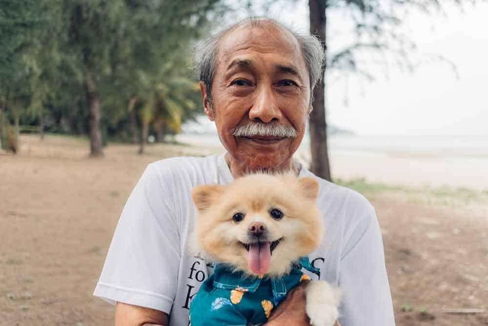 man-holding-dog