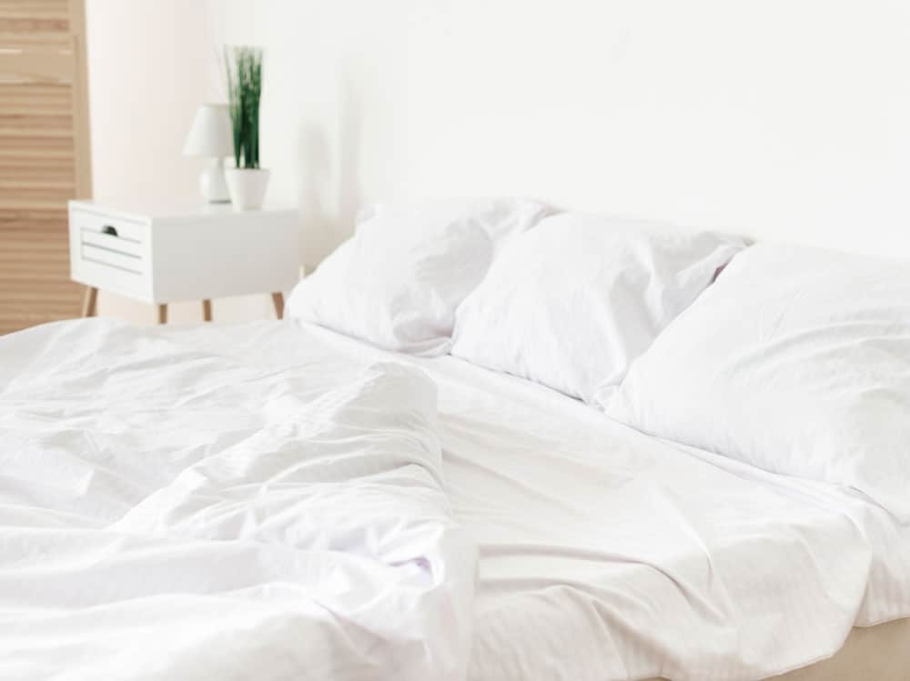 bright-modern-bedroom-with-white-sheets