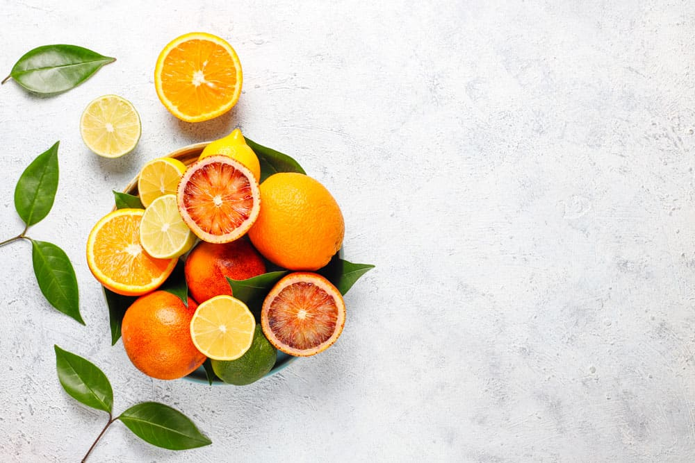 citrus-background-with-assorted-fresh-citrus-fruits