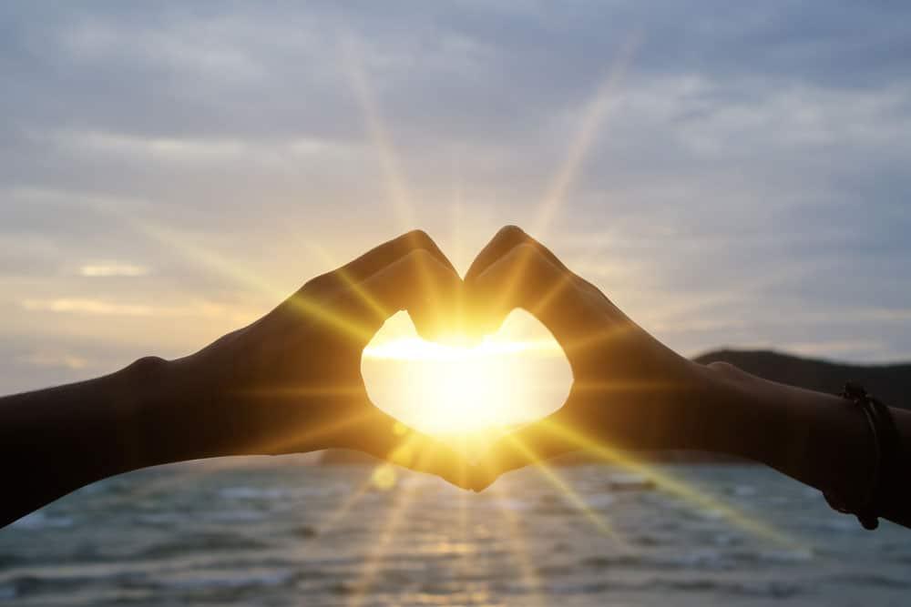 hand-making-heart-sun