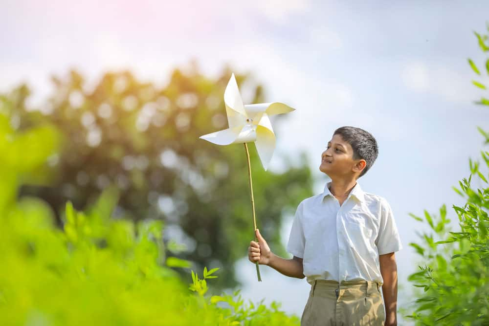indian-child-running-playing-with-pinwheel