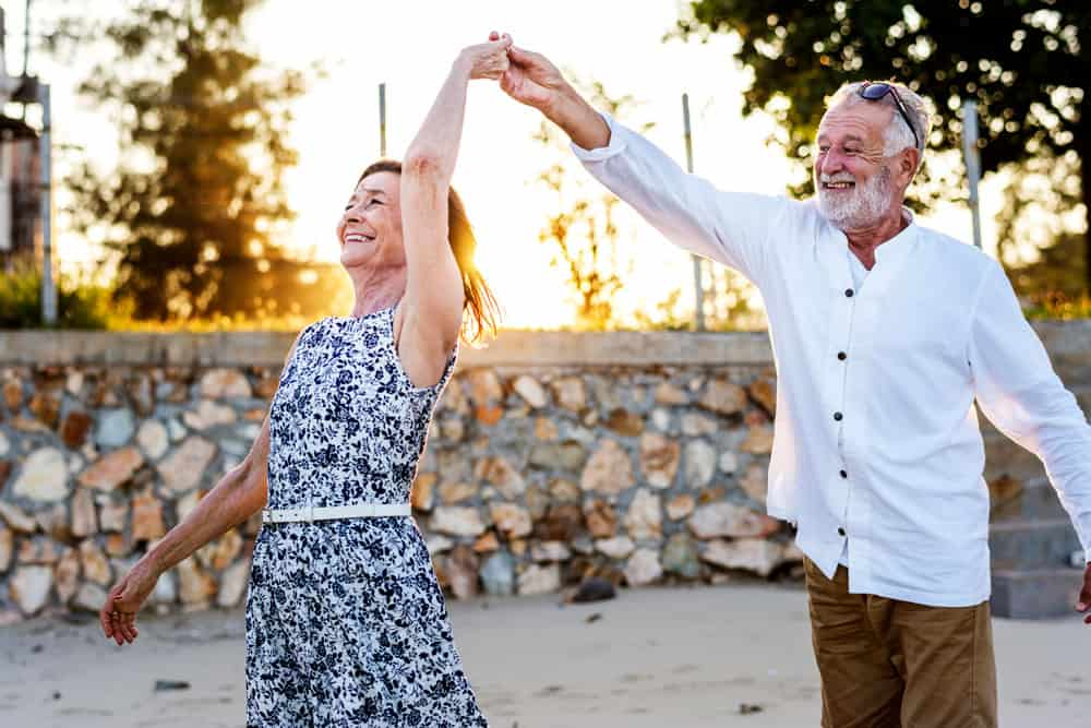 seniors-enjoying-tropical-beach