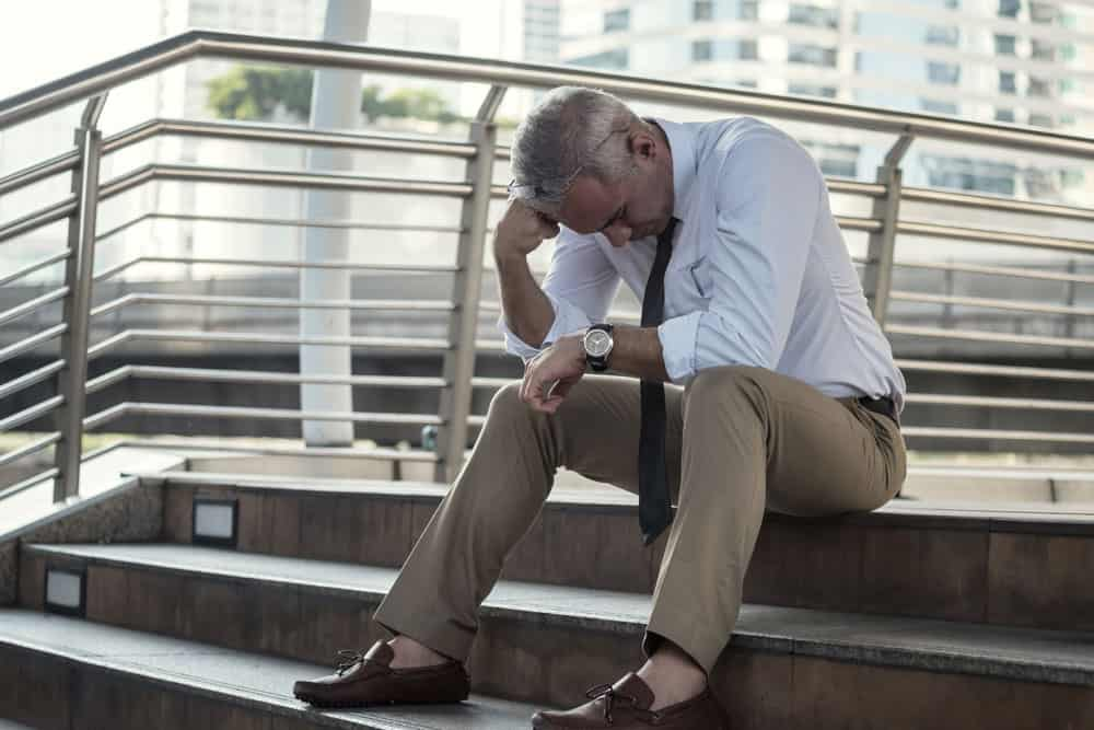 stressed-overwhelmed-senior-businessman-sit-stair-outside-office-downtown-city