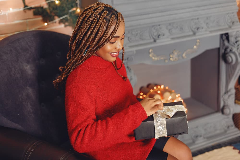african-girl-christmas-decorations-woman-red-sweater-new-year-concept
