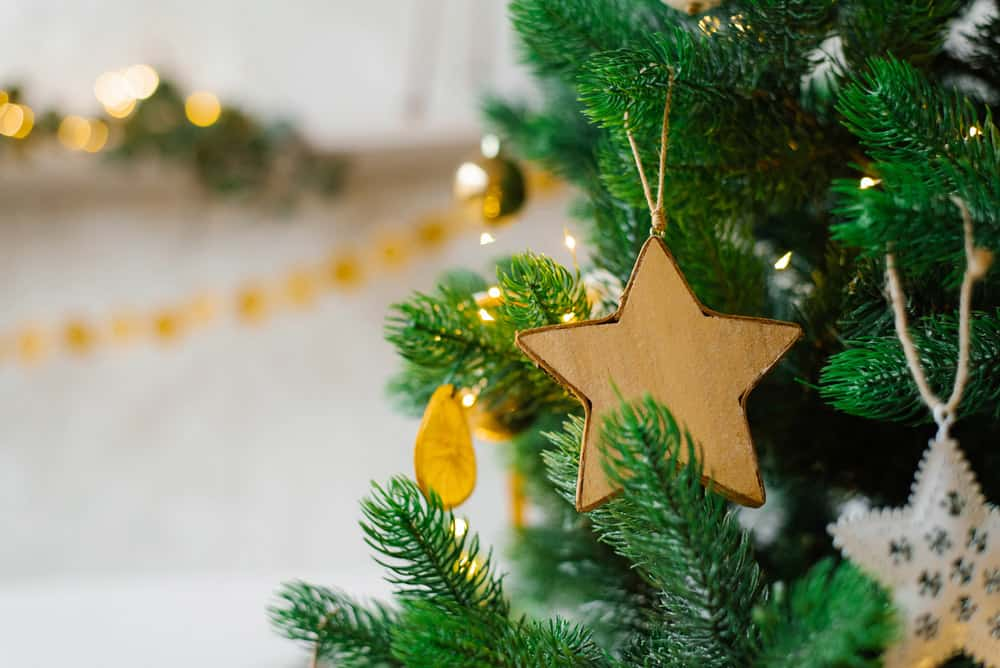 christmas-tree-is-decorated-with-toys-golden-balls-white-eggs-garlands-close-up