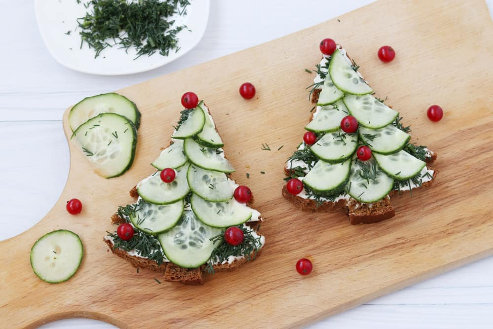 sandwiches-made-black-bread-cheese-cucumber-form-christmas-tree-decorated-with-berries