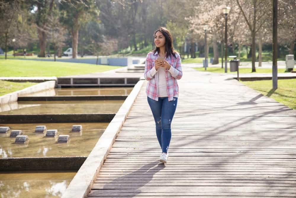 smiling-delighted-girl-enjoying-landscape-city-park
