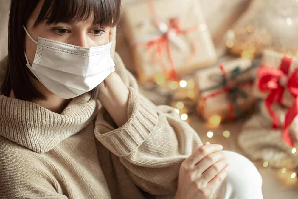 young-woman-with-mask-her-face-cozy-beige-sweater