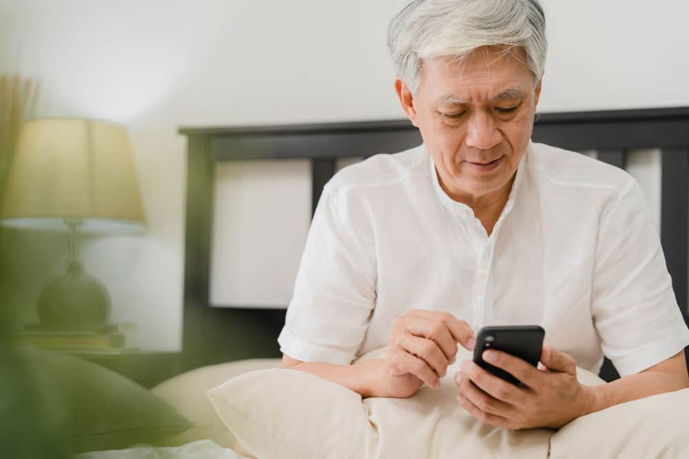 asian-senior-men-using-mobile-phone-home-asian-senior-chinese-male-search-information-about-how-good-health-internet-while-lying-bed-bedroom-home-morning-concept