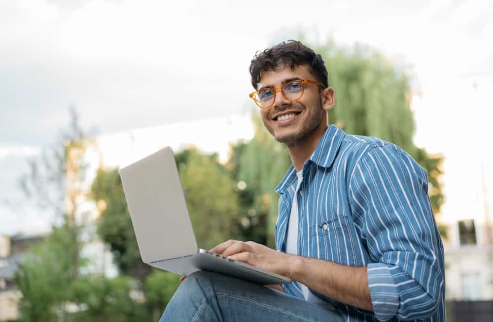 handsome-copywriter-using-laptop-computer