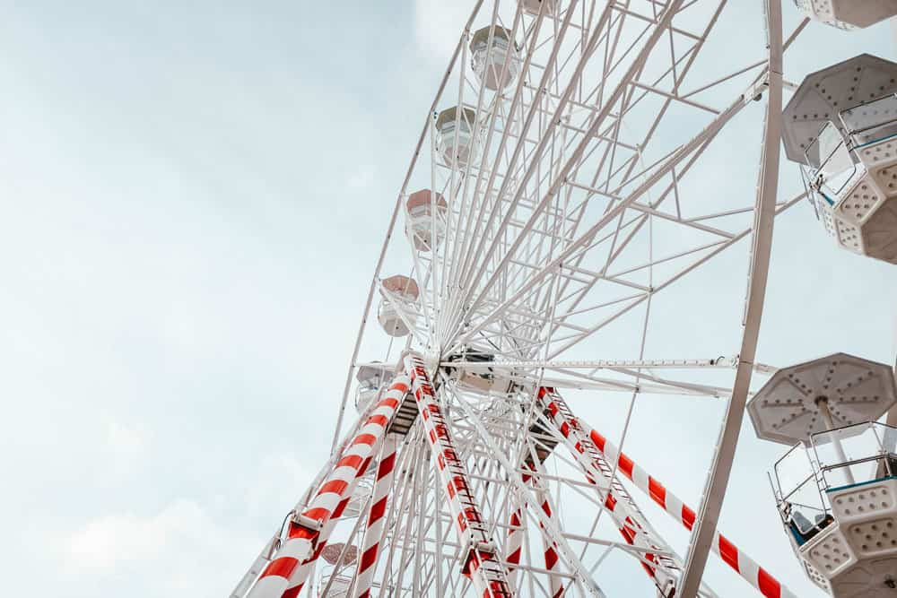low-angle-closeup-ferris-wheel-carousel-with-red-white-stripes