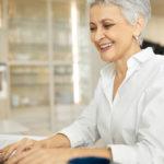 woman-at-computer-at-work-desk