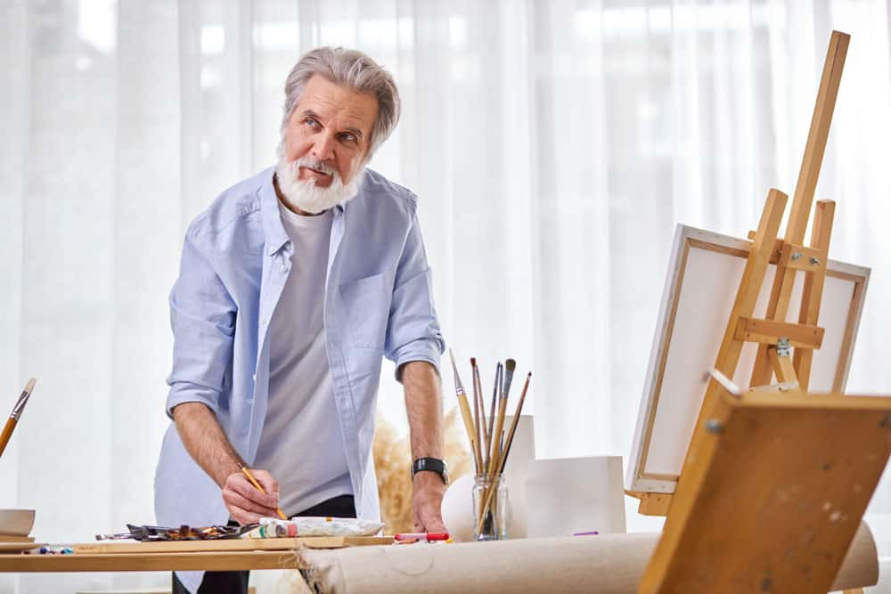 artist-during-work-stand-contemplation-thinking-while-drawing-using-tools-painting
