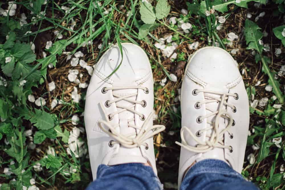 pair-white-shoes-green-grass