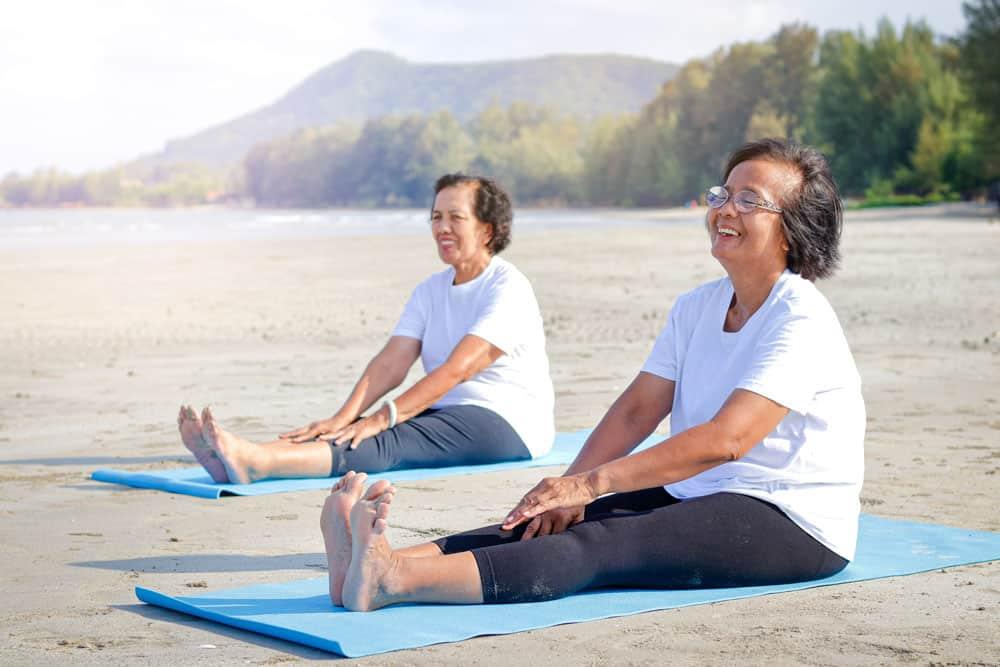 two-elderly-women-exercise-beach-happy-smile-concept-elderly-community