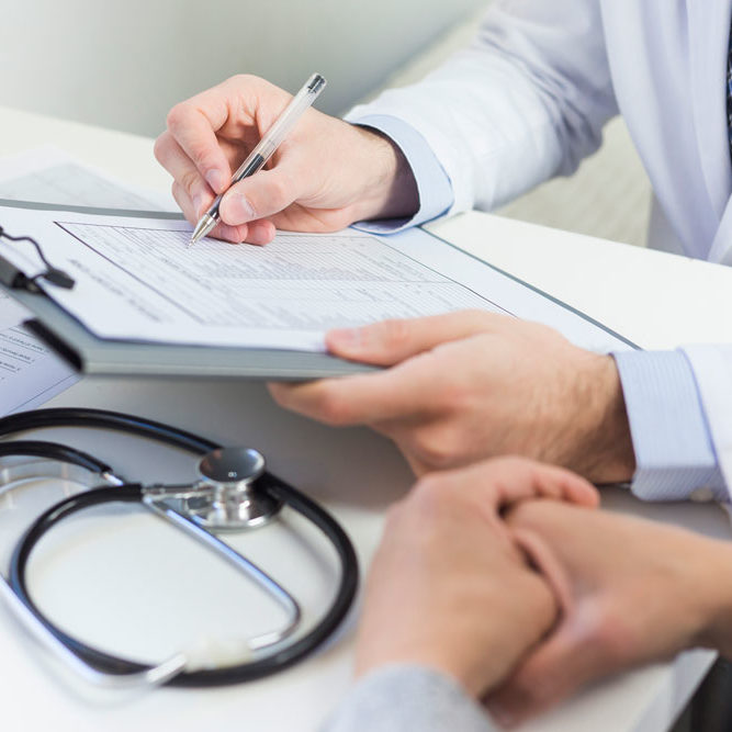 close-up-doctor-filling-medical-form-with-patient