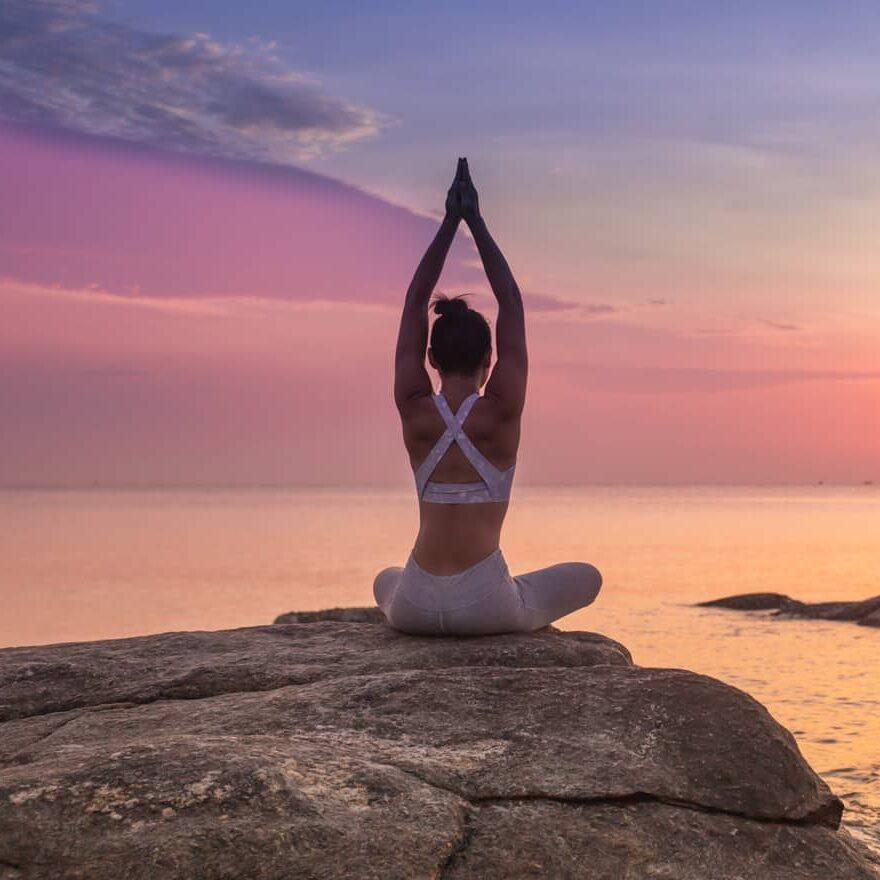 girl-practicing-yoga-rock