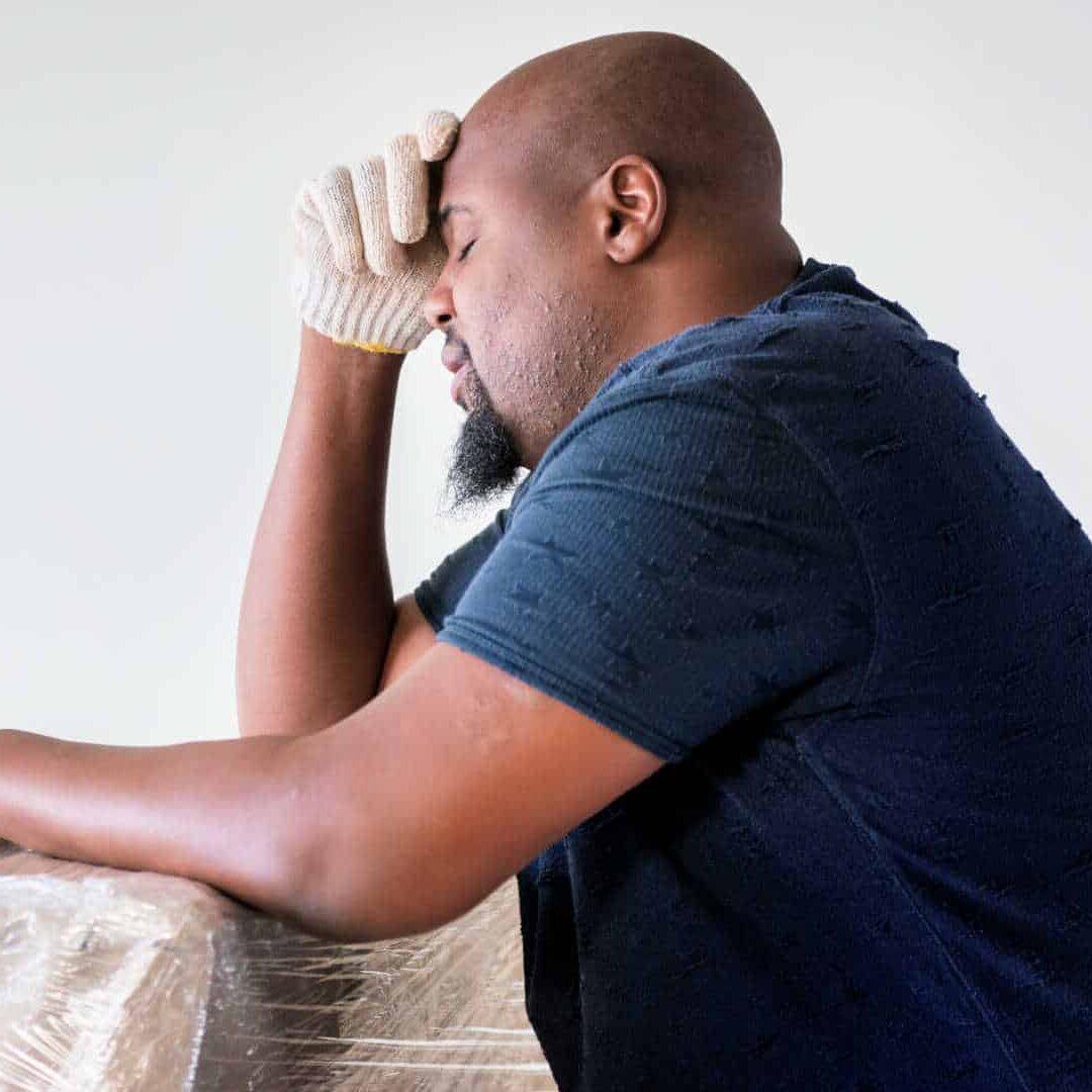 man-stressed-holding-head