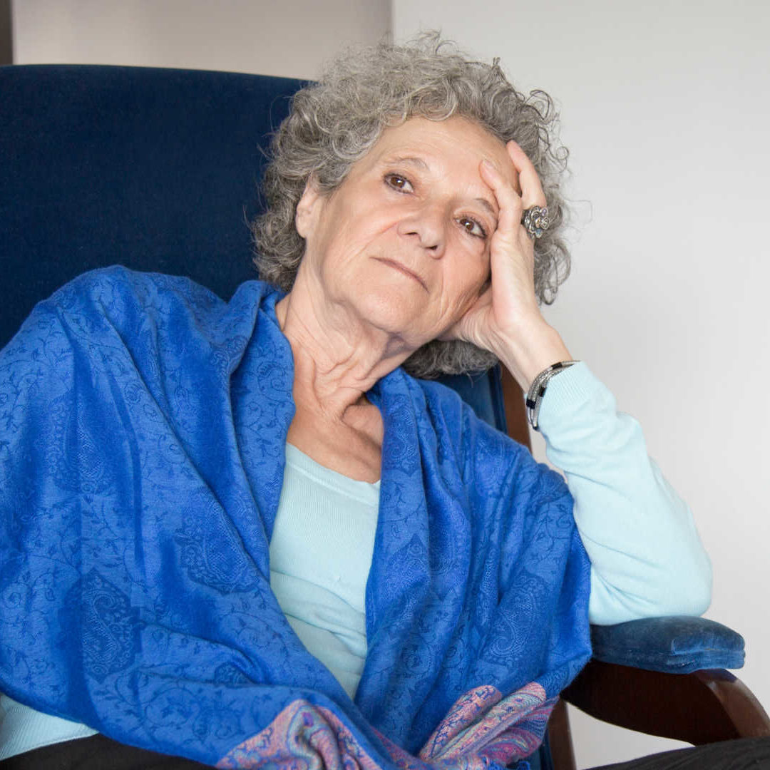 pensive-senior-lady-sitting-rocking-chair